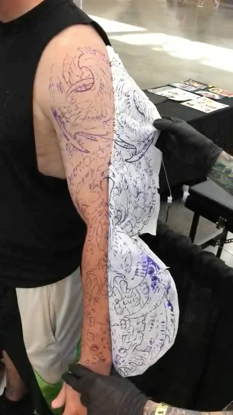 Don McDonald applying a large stencil for a sleeve